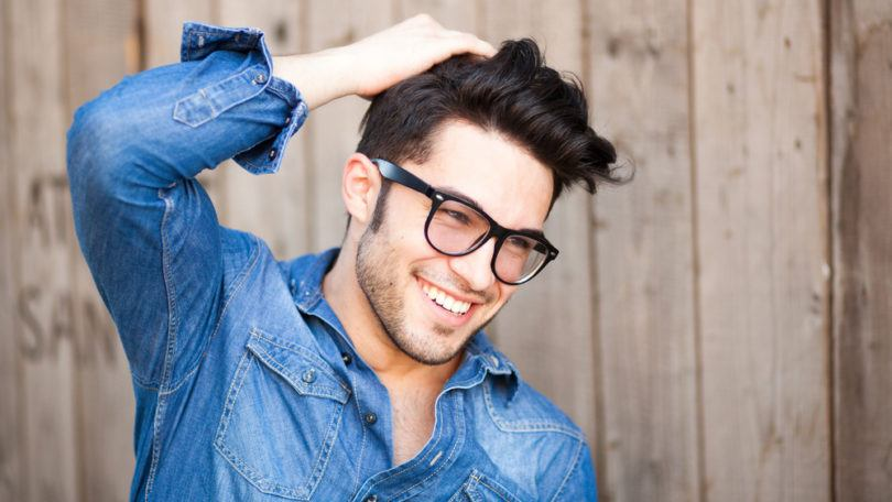 Young man with long hairstyles for men with thick hair in glasses