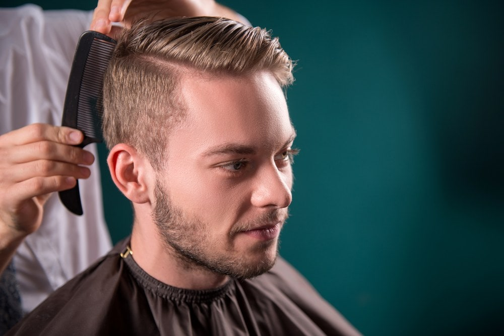 Styling with hair wax for men to create the hard part haircut