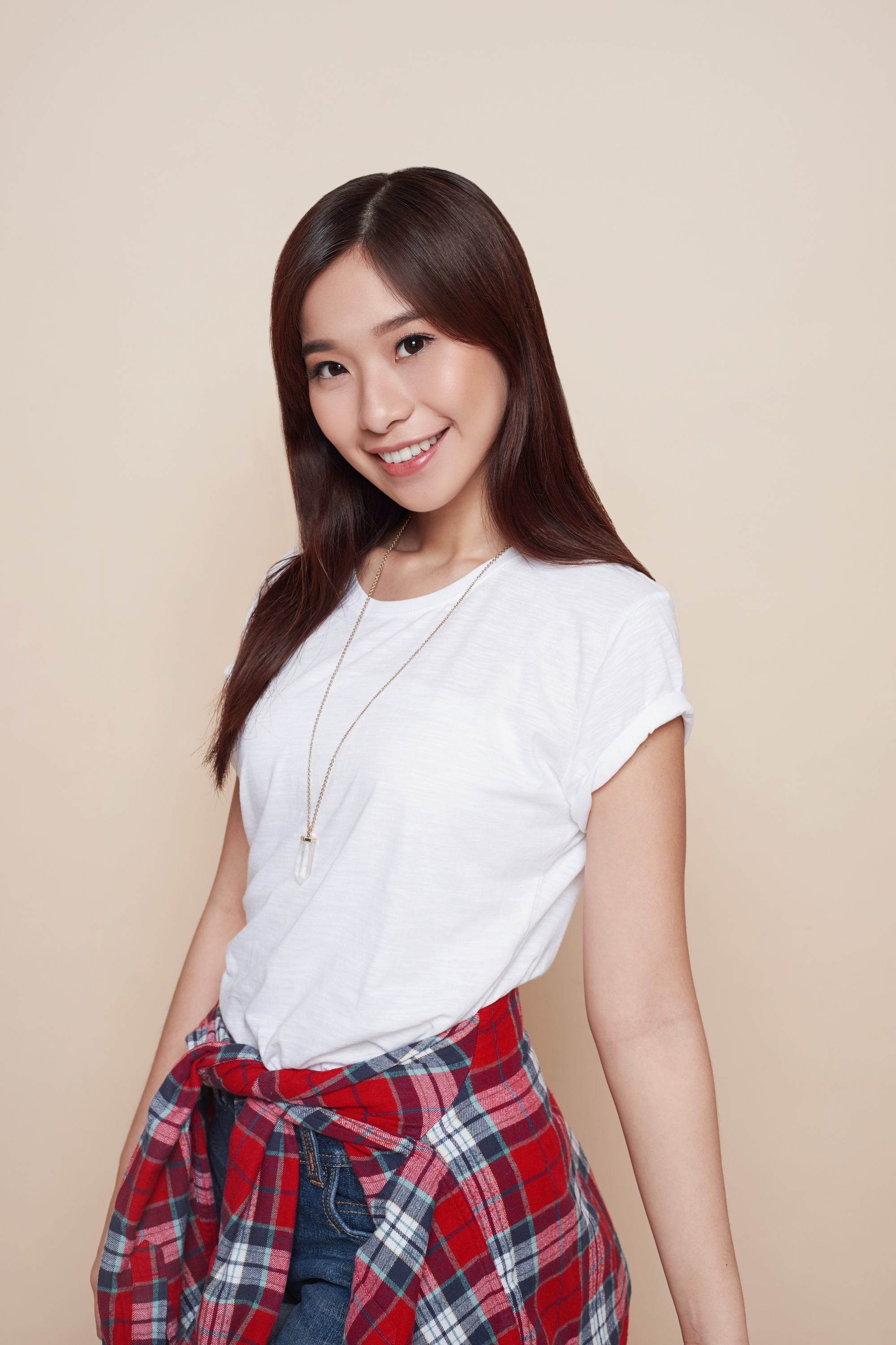 Blow dry your hair: Asian woman with long dark hair wearing a white shirt