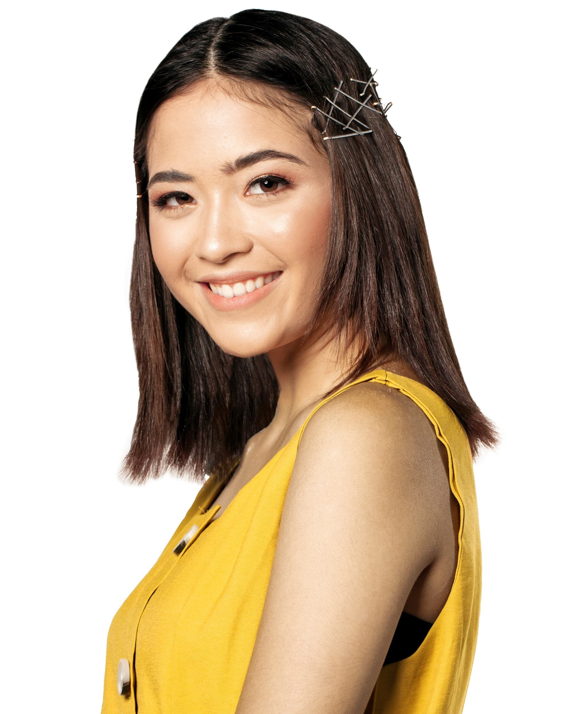 Bobby pin hair crown: Asian woman with shoulder-length brown hair smiling