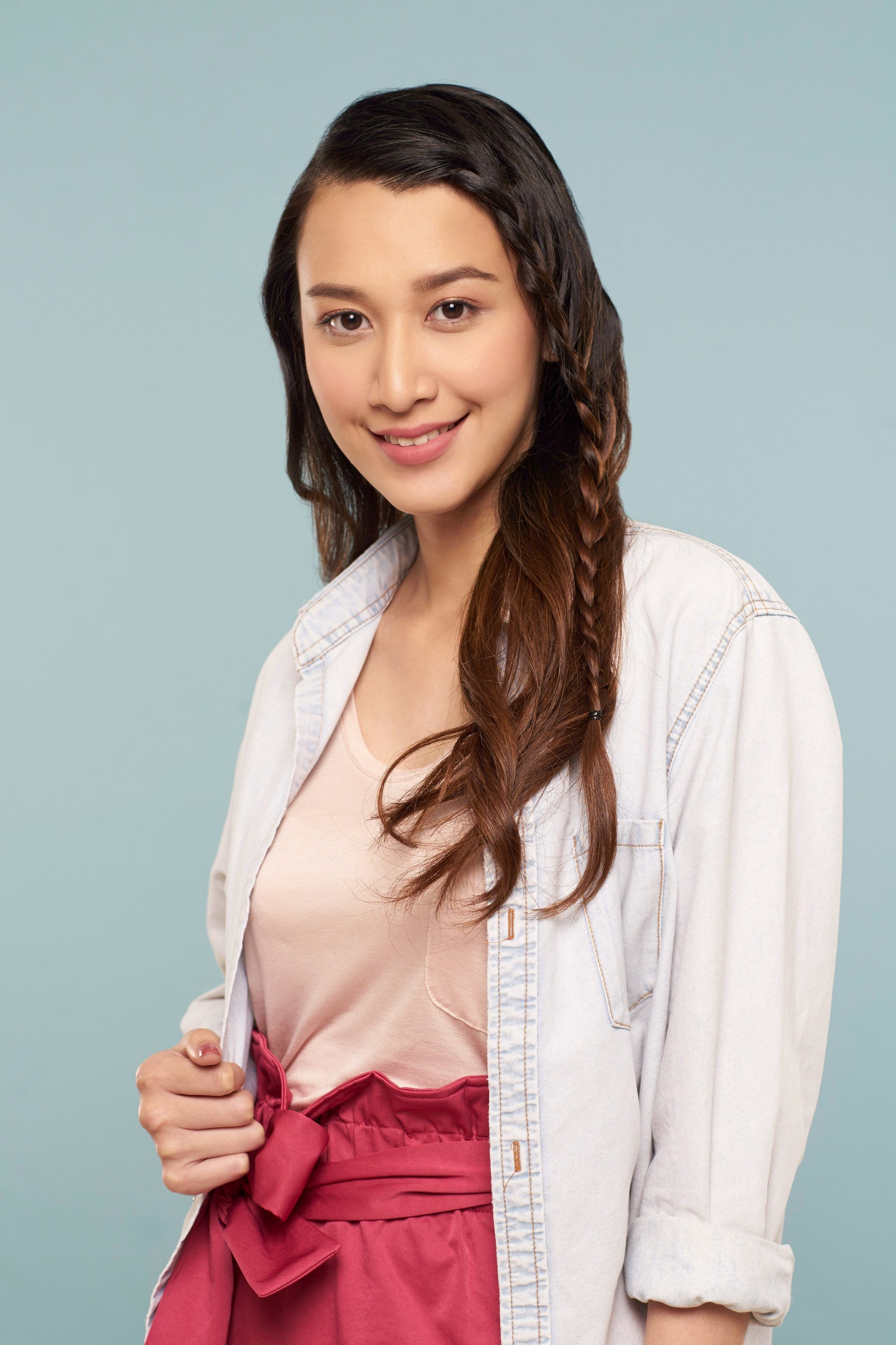Casual hairstyles: Asian woman with long dark brown hair with lace braid wearing a white jacket and light pink shirt