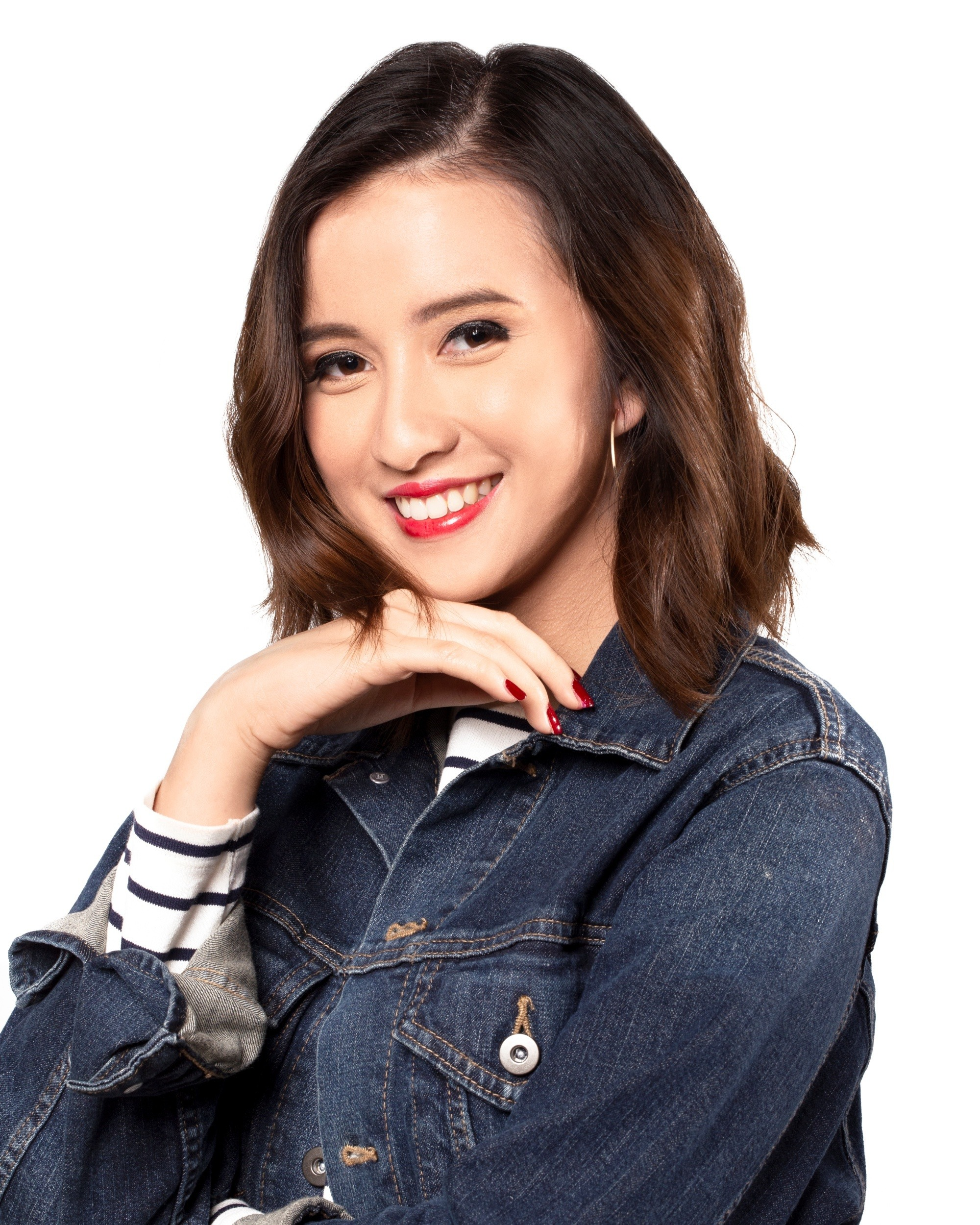 Casual hairstyles: Asian woman with dark brown messy layered bob wearing a denim jacket smiling