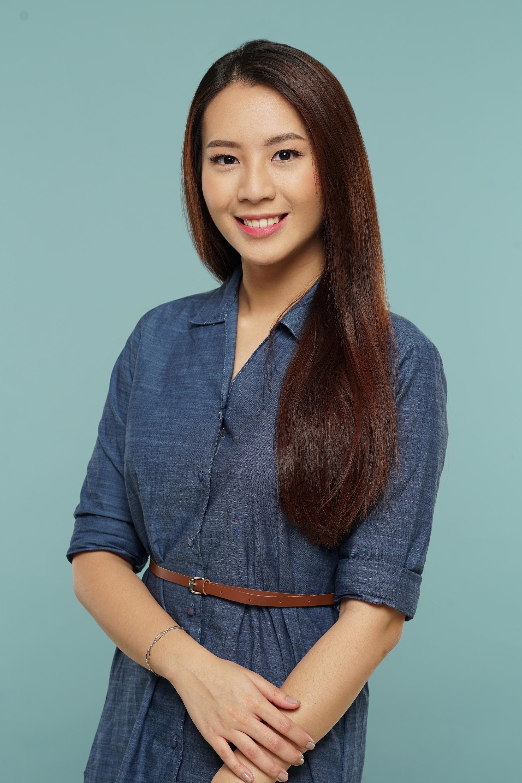 Anti-dandruff shampoo: Asian woman with long dark straight hair wearing a denim dress