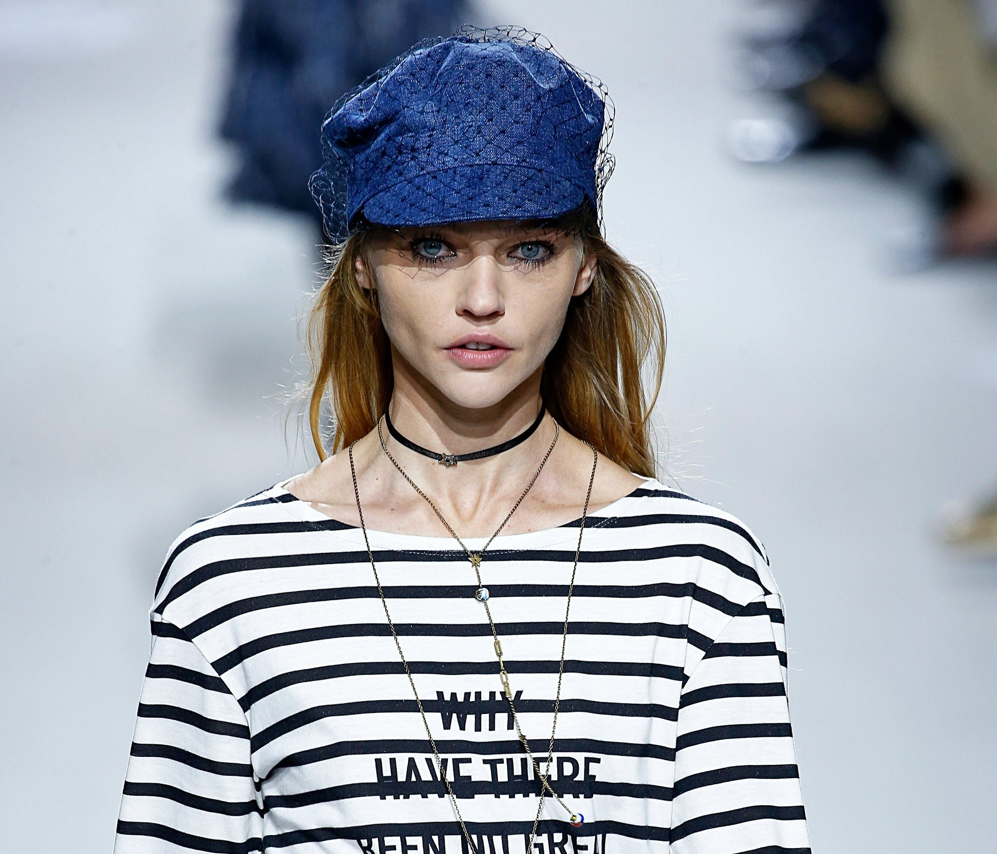 Wear a hat: One way on how to hide bangs