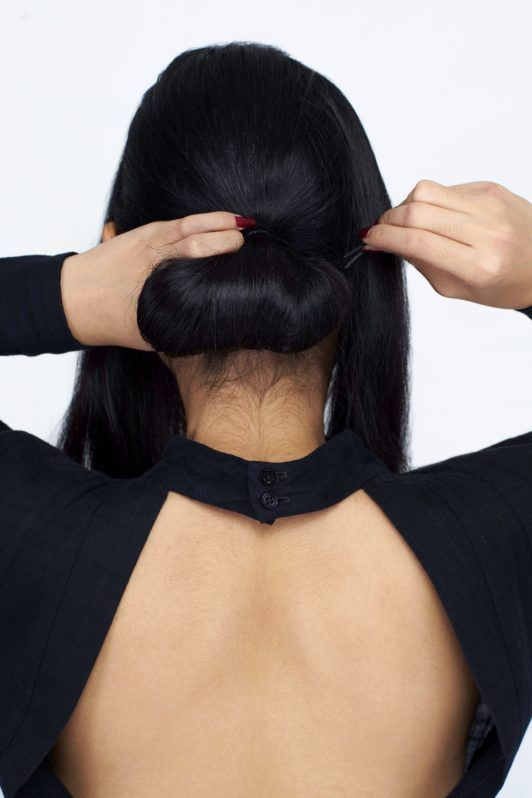 How to make a chignon step 4: Roll hair up to your nape until you make a low bun.