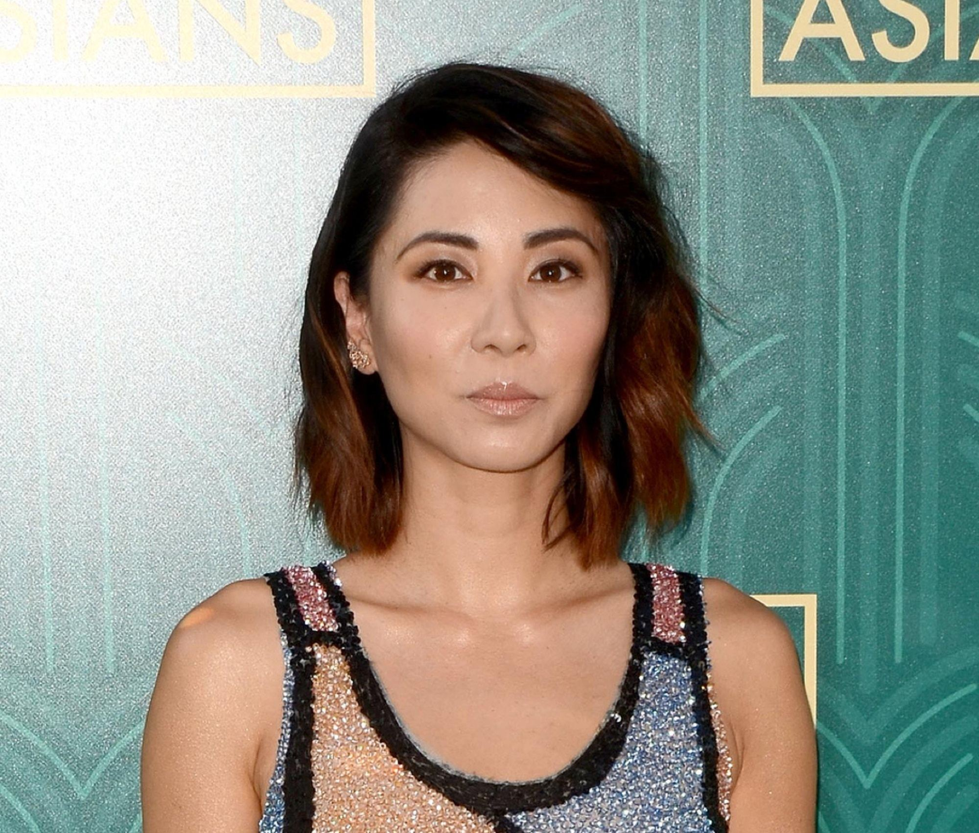 Crazy rich hairstyles: Asian woman with wavy lob