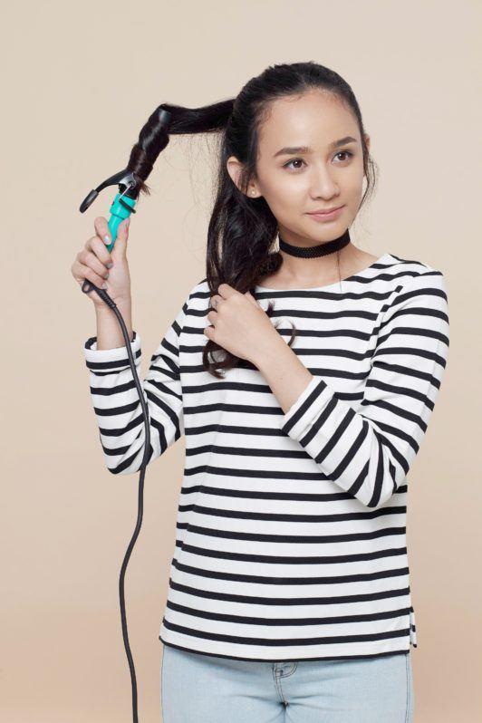 How to make a messy bun for long hair step 3: Curl hair