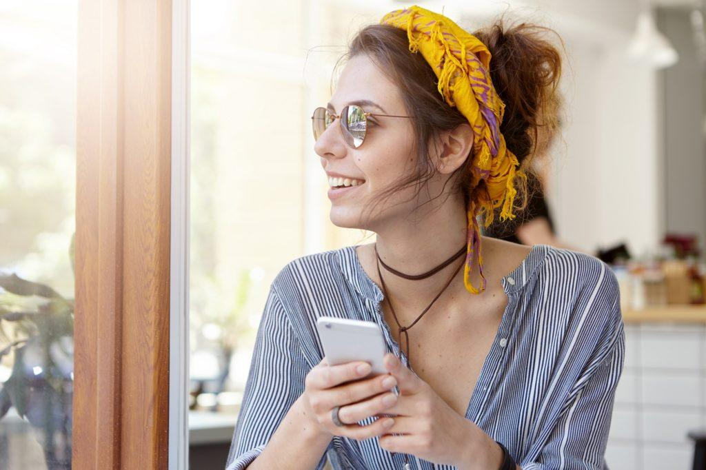 Weekend hairstyles for touring around manila: Woman with headband and hair in messy bun