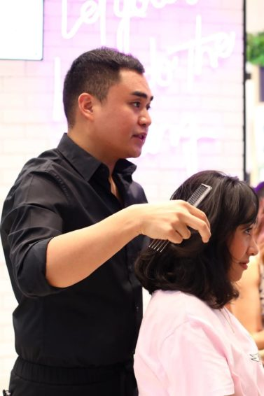 Hairstylist Jay Wee giving a free hair makeover