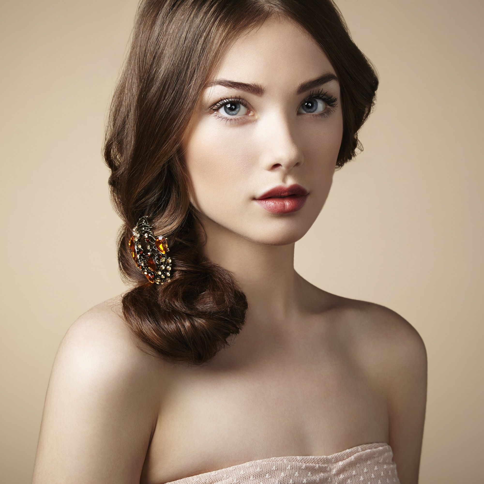 Woman with a side bun hairstyle and ash brown hair color