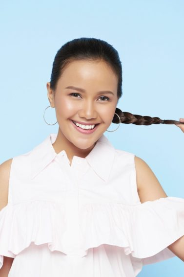 Easy braids for long hair: Asian woman holding her Dutch braid