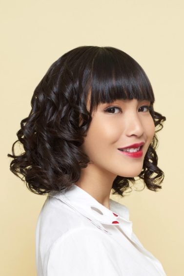 Easy hairstyles for medium hair: Asian woman with spiral curls and bob hair