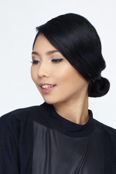 Elegant updos: Asian woman with black hair in chignon