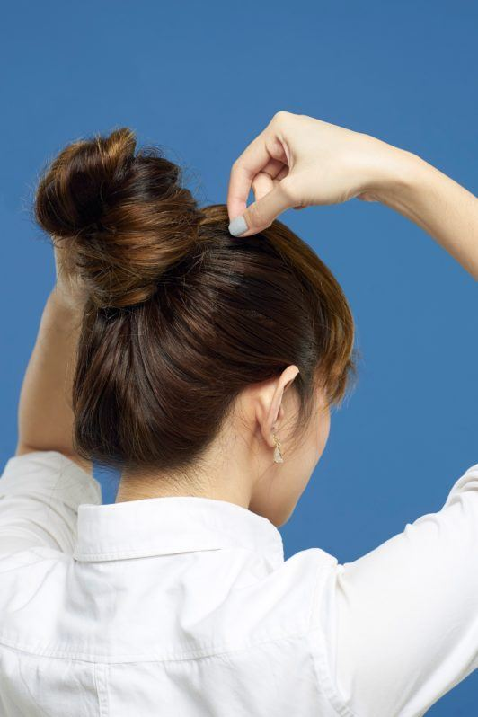 Making faux bangs 5: Asian woman making a ballerina bun