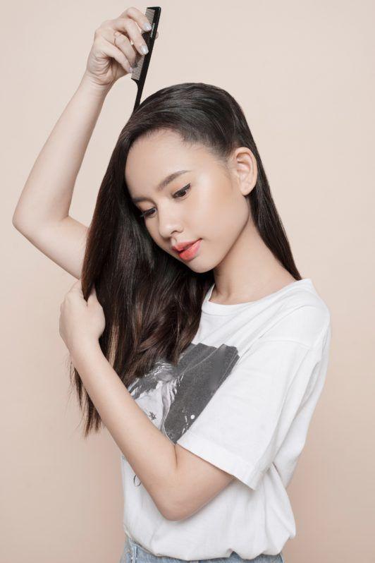 Headband braid: Asian girl parting her long hair