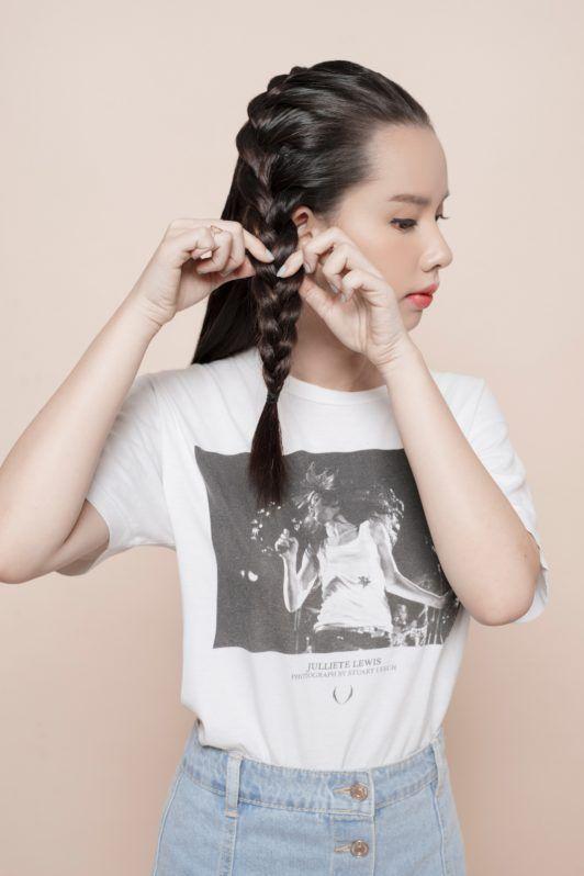 Headband braid: Asian girl tugging her braid
