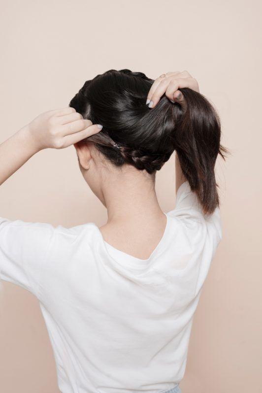 Headband braid: Asian girl tucking her braid under her hair