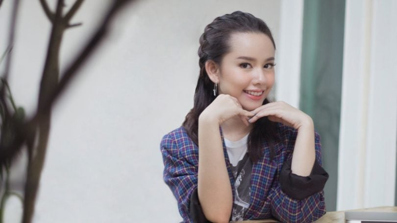 Headband braid: Asian girl with headband braid sitting outside
