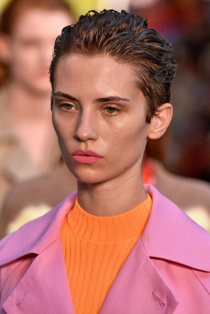 Short hairstyles for heart shaped faces: Woman with slicked back pixie cut
