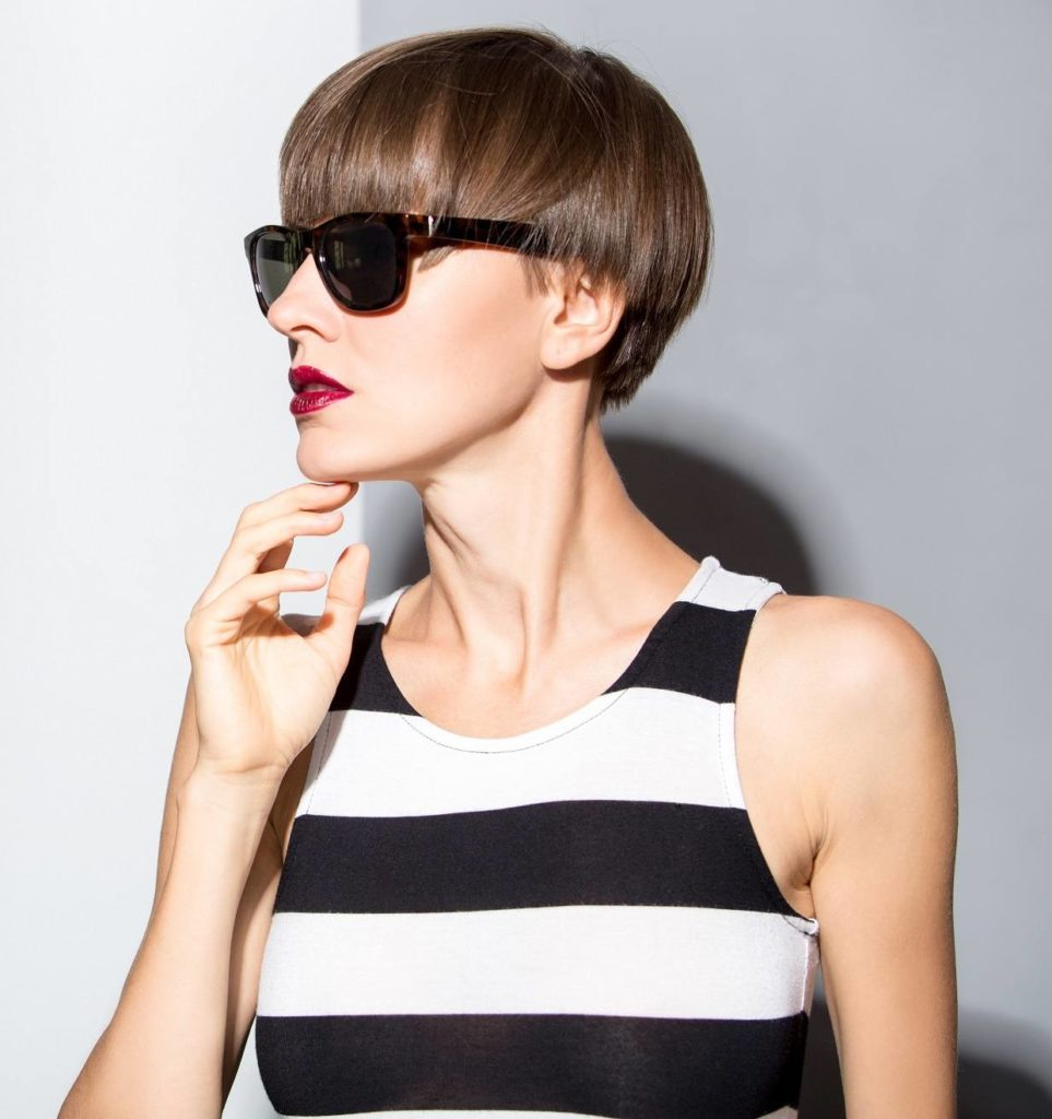 Short straight hairstyles: Woman with short hair pixie cut wearing sunglasses