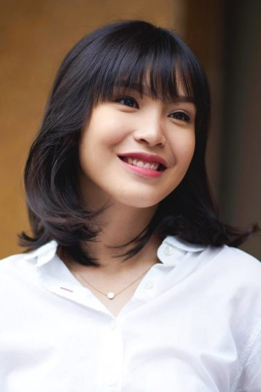 Woman with shoulder length bob and bangs