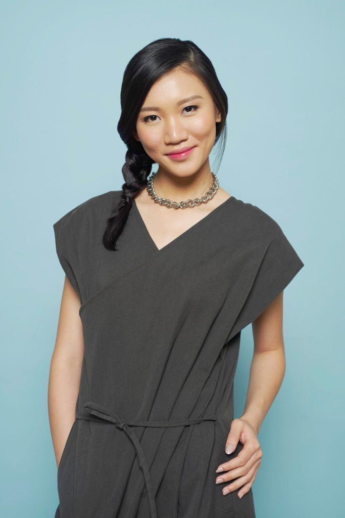 Side hairstyles: Asian woman with side braid