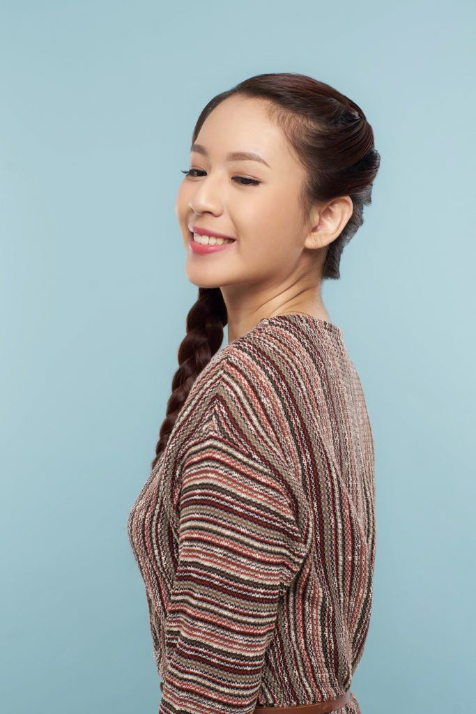 Side hairstyles: Asian woman with side French braid