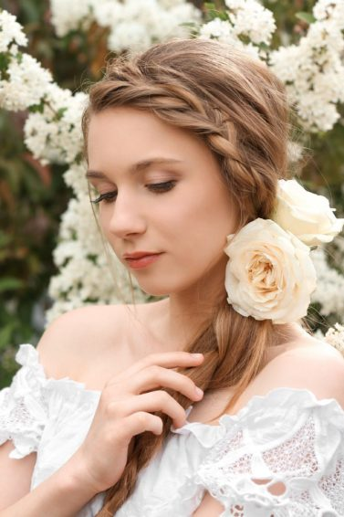 Wedding hair braids: Woman with headband side braid wearing a wedding dress