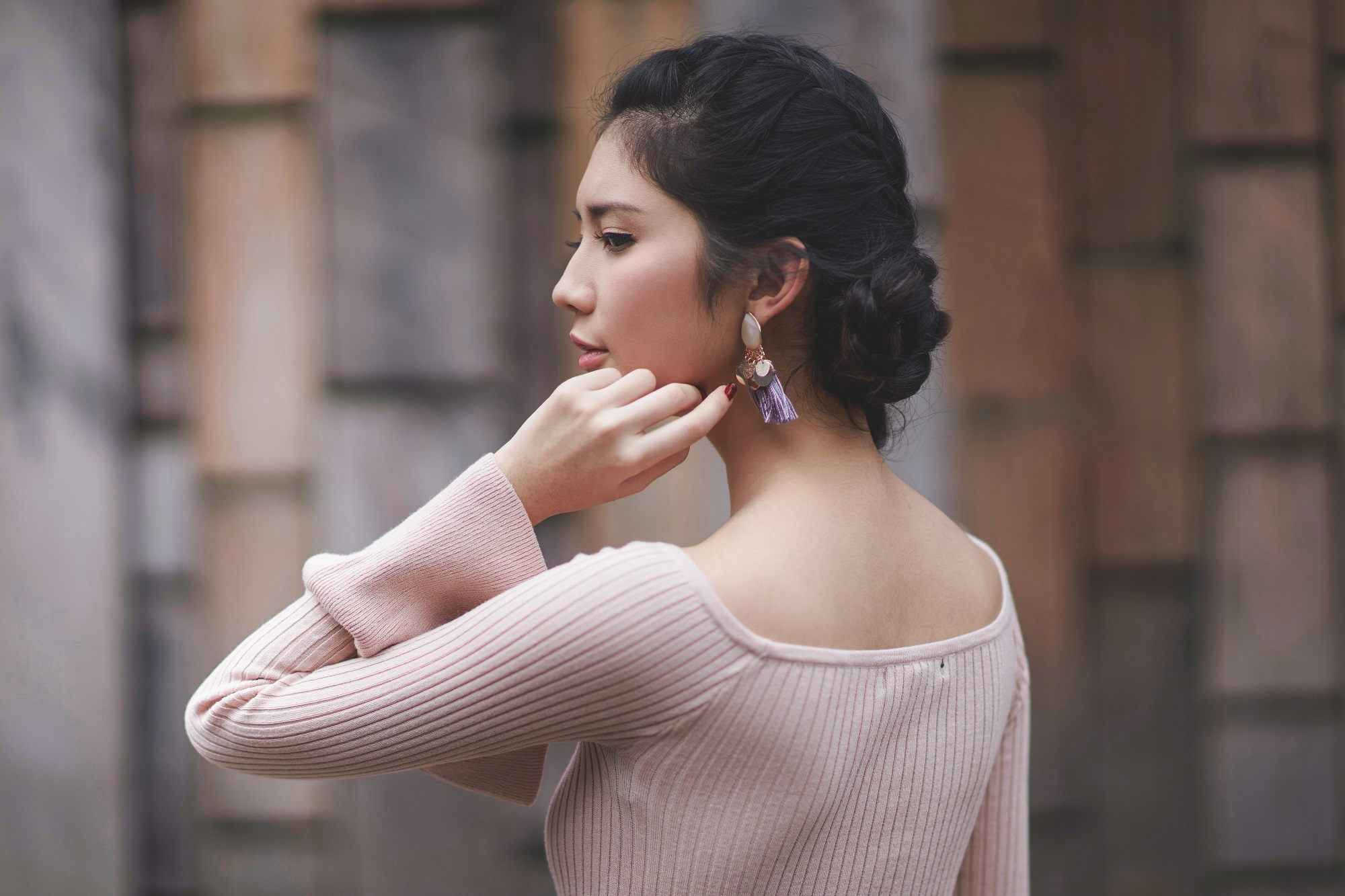 Wedding hair braids: Asian woman with side braid bun
