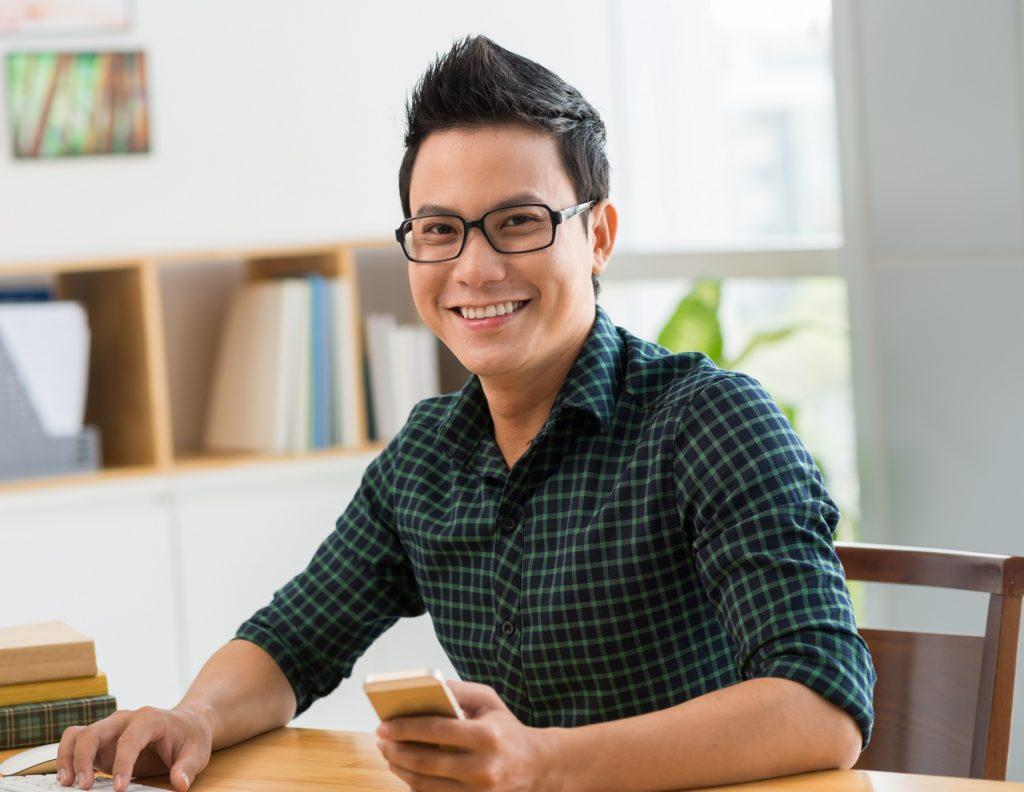 Asian hairstyles men: Asian man with quiff hair and eyeglasses