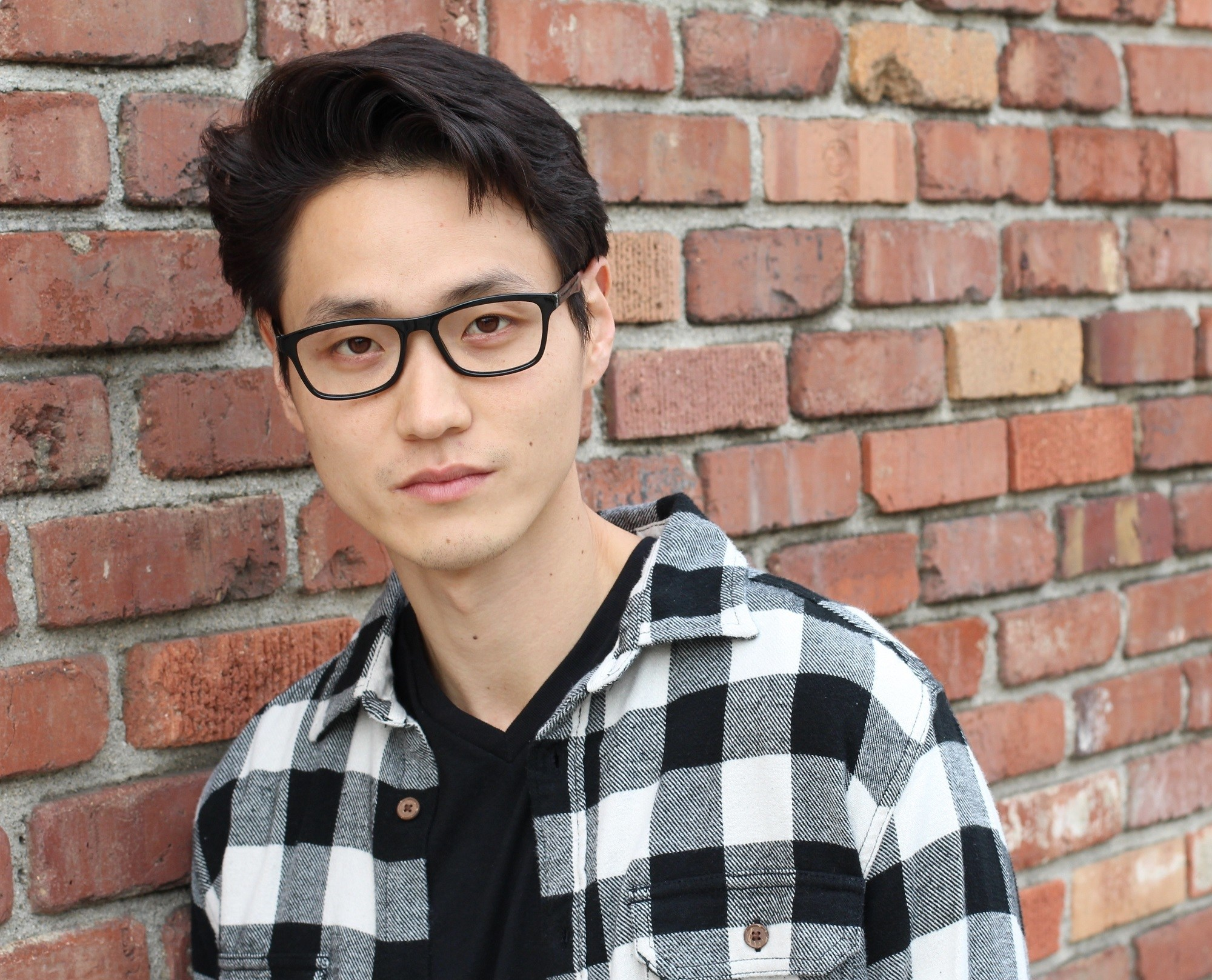 Asian hairstyles men: Asian man with side-swept quiff
