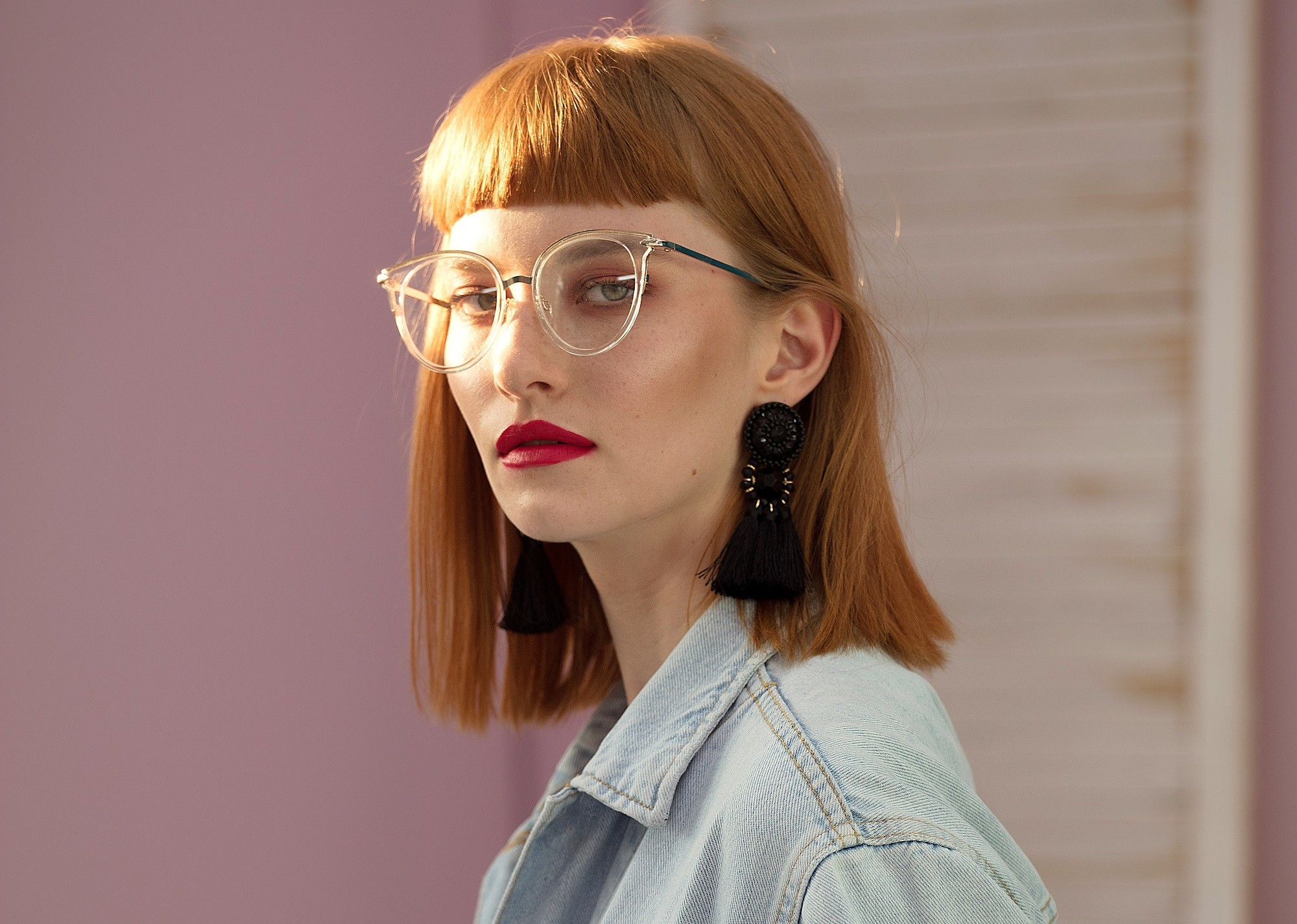 Woman with long bob and blunt bangs with glasses