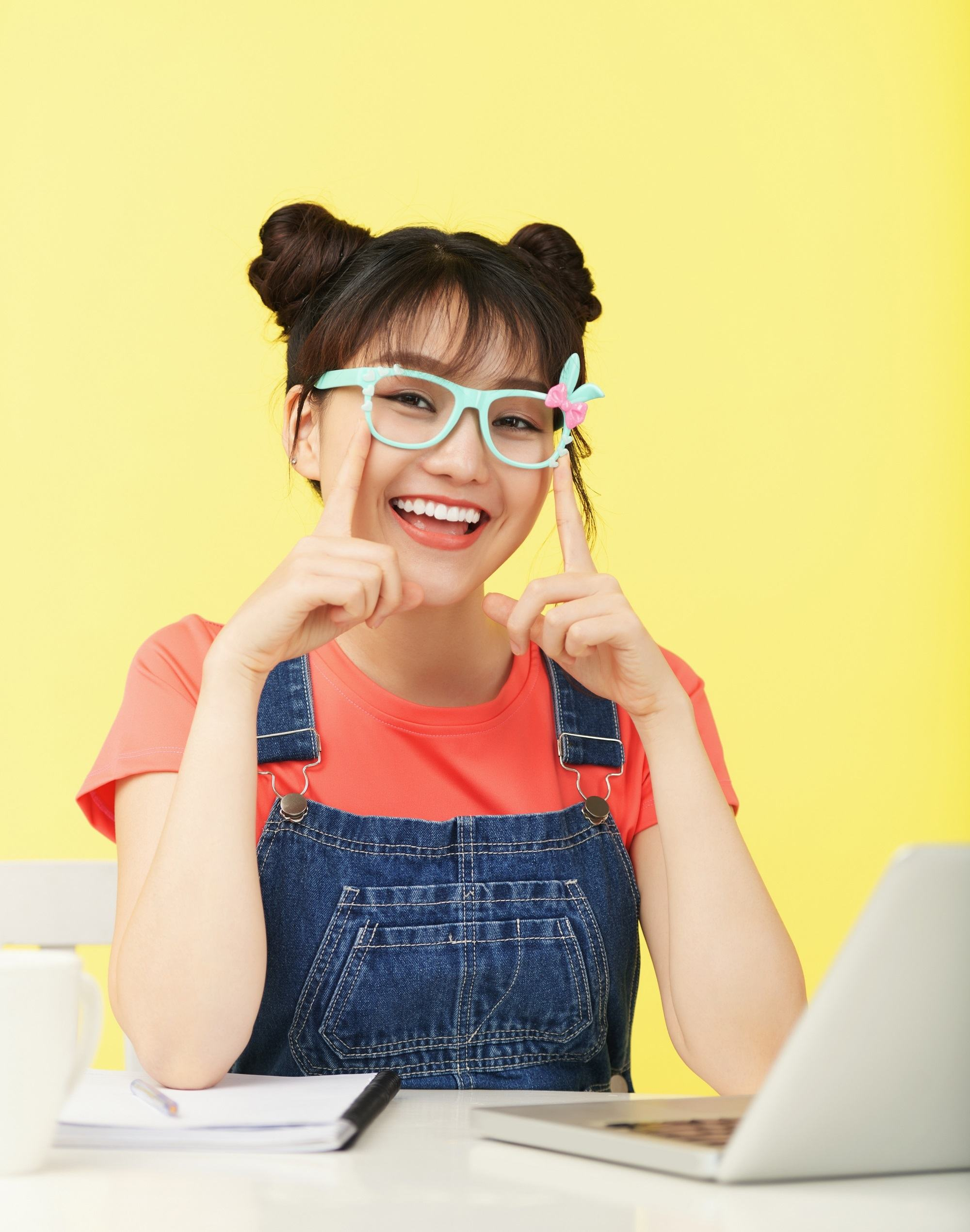 Girl with double buns and see-through bangs with glasses