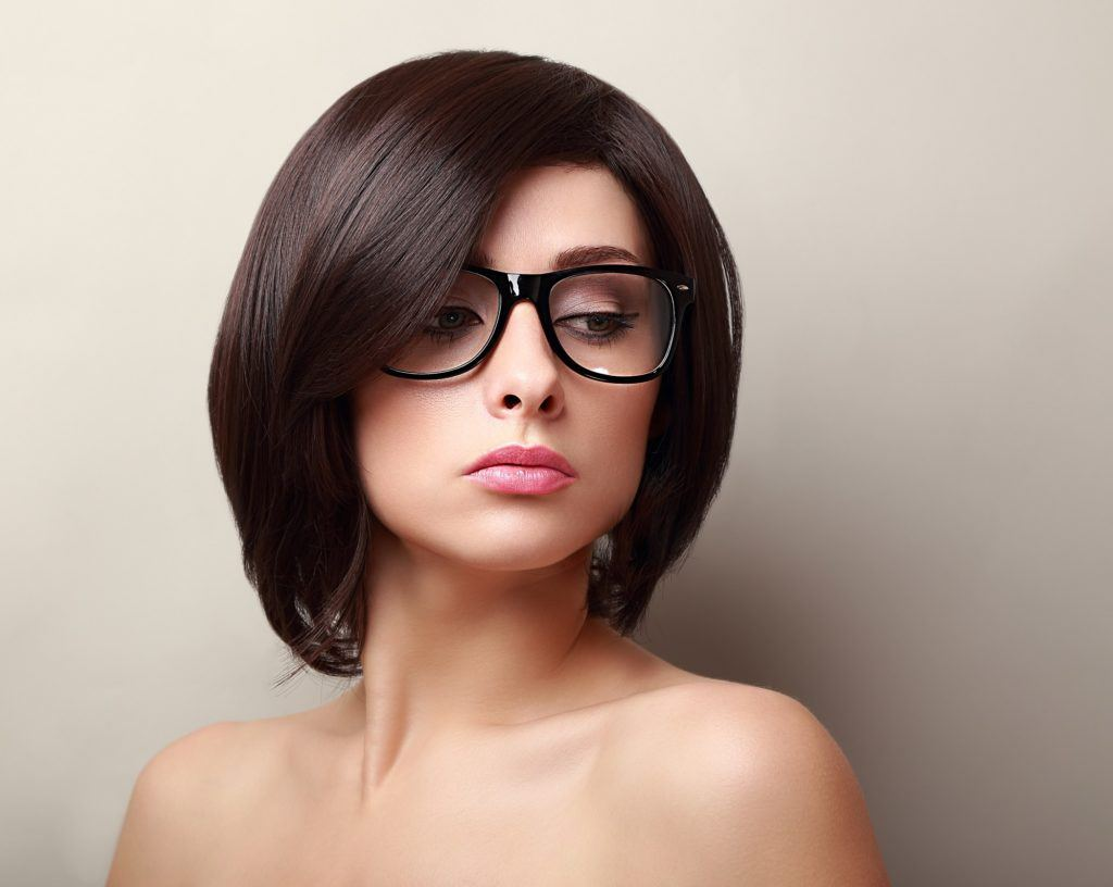 Woman with bob and side bangs with glasses