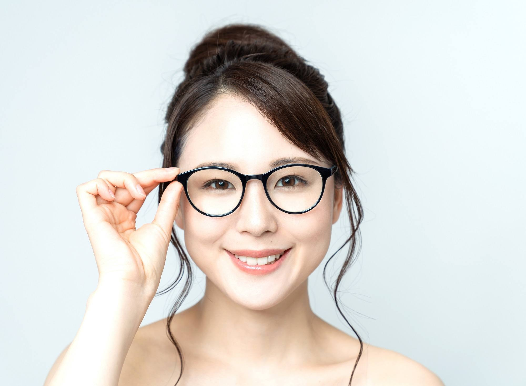 Asian woman with bangs with glasses