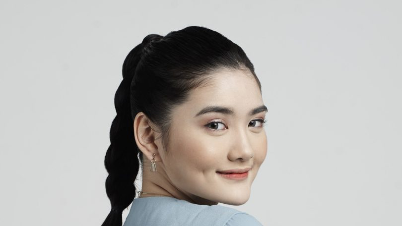 Asian woman with braid ponytail