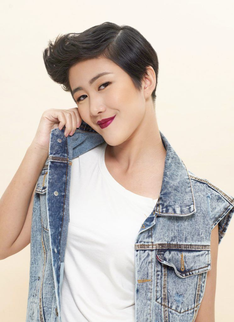 Different hairstyles for short hair: Asian woman with pixie cut and quiff hair