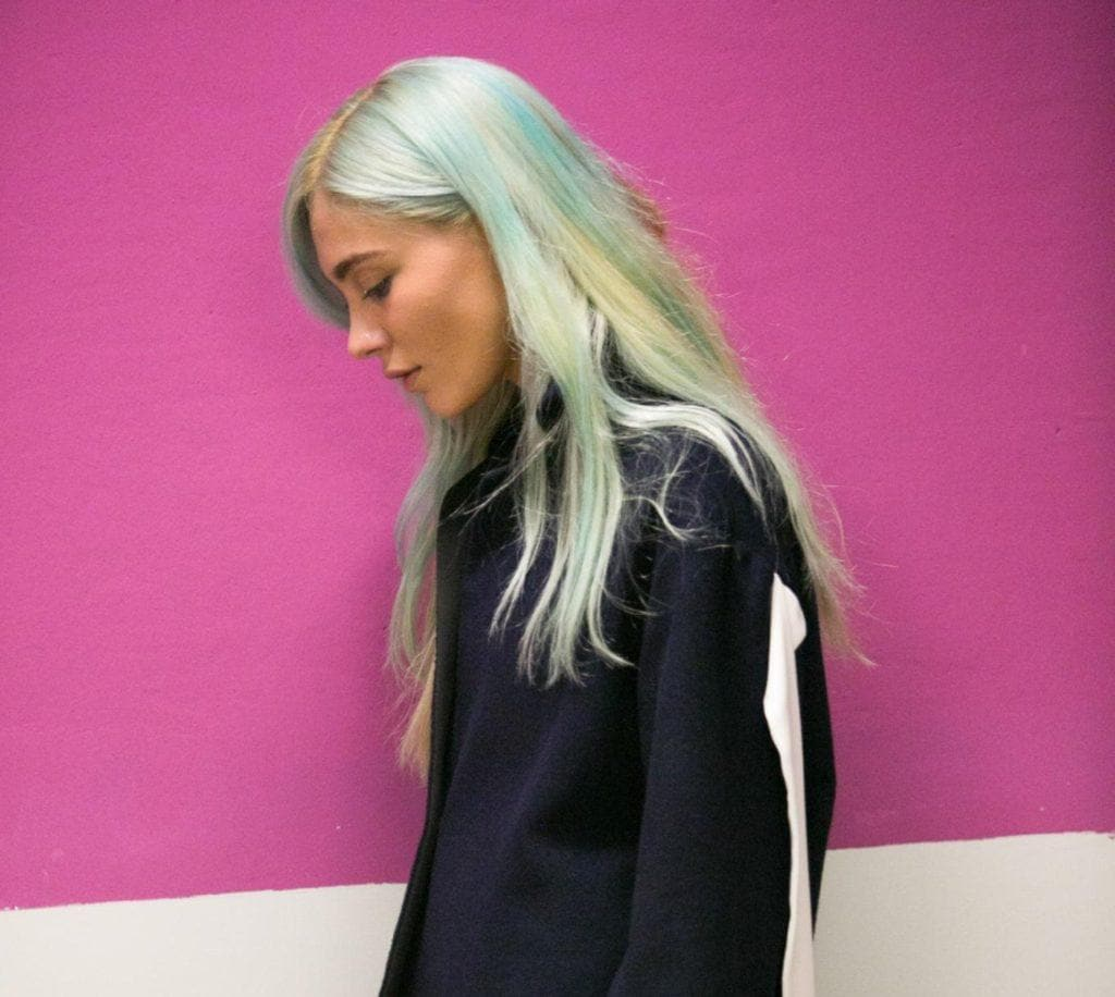 Woman with long mint green hair