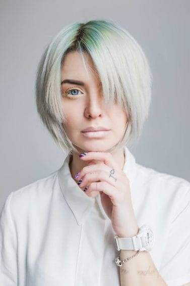 Woman with green hair bob hairstyle