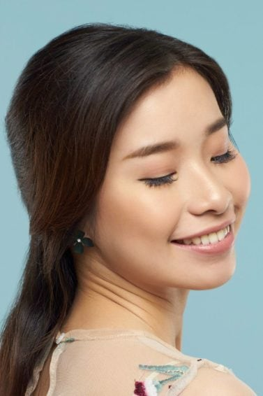 Asian woman with half up half down with braid