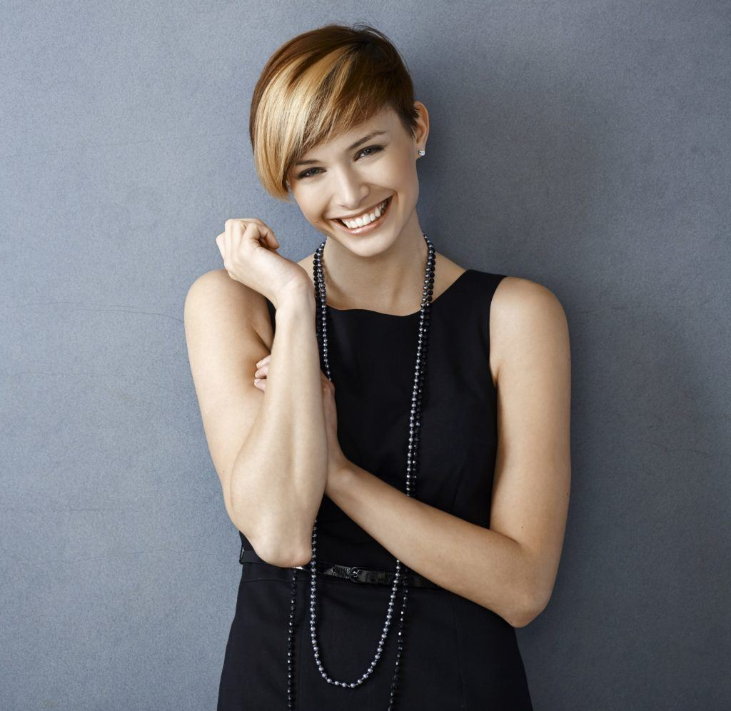Short hair with bangs: Woman with blonde pixie cut with long bangs