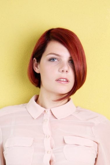 Short red hair: Woman with red asymmetrical bob