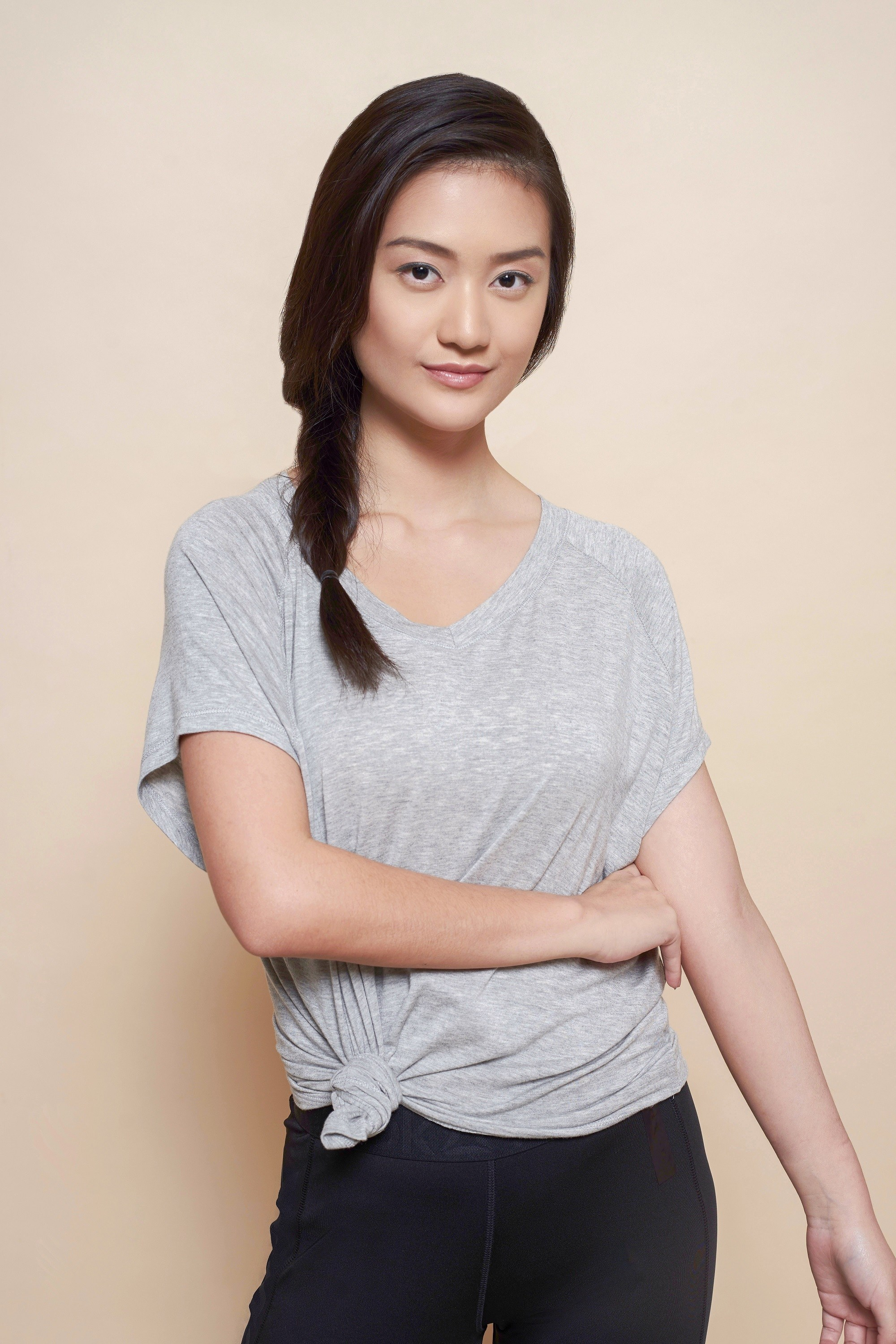 Side hairstyles: Asian woman with side fishtail braid