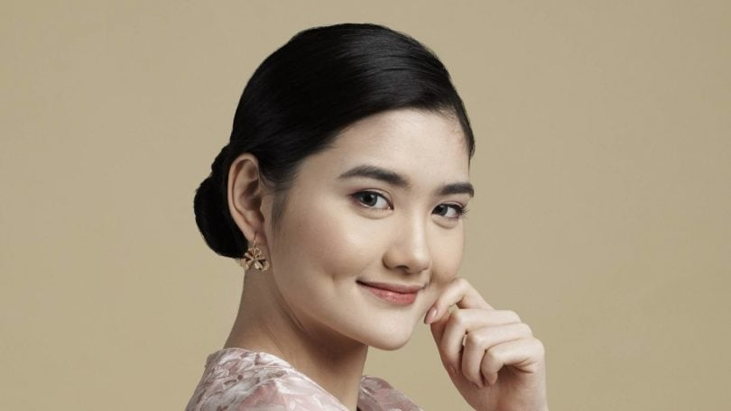 Asian woman with sleek low bun with side part