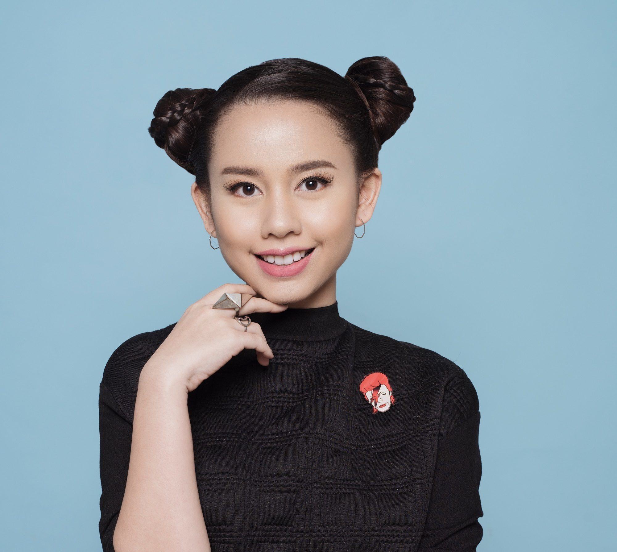 Advent calendar: Closeup shot of Asian girl with black hair in space buns wearing a black shirt