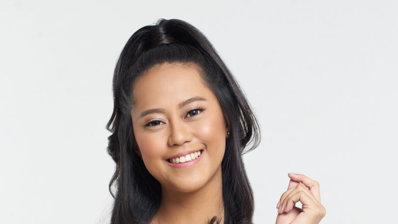 Half ponytail: Closeup shot of an Asian woman with shoulder-length black hair in half ponytail