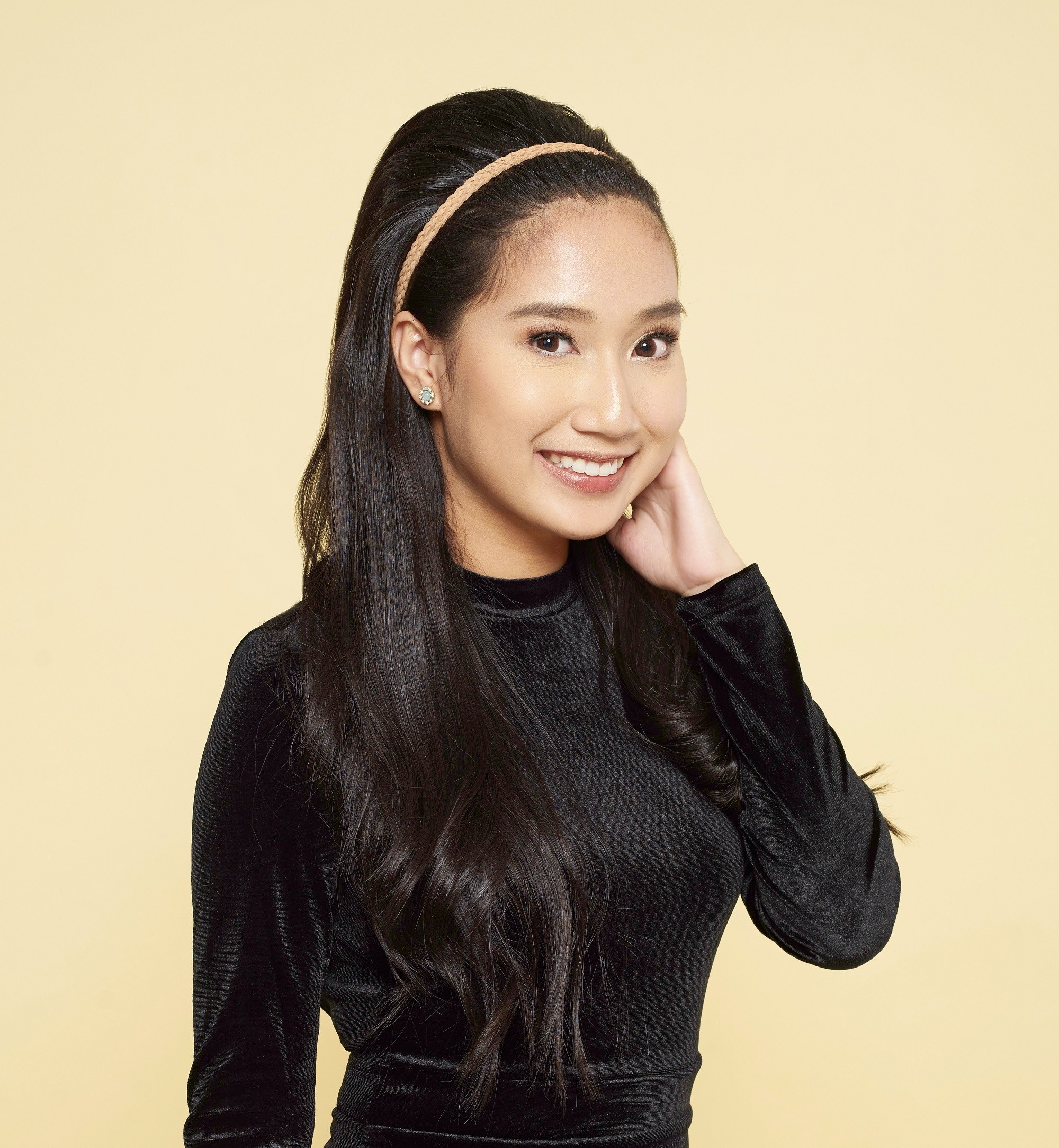 Christmas party hairstyles: Asian woman with long black hair in bouffant hairstyle wearing a black long-sleeved dress