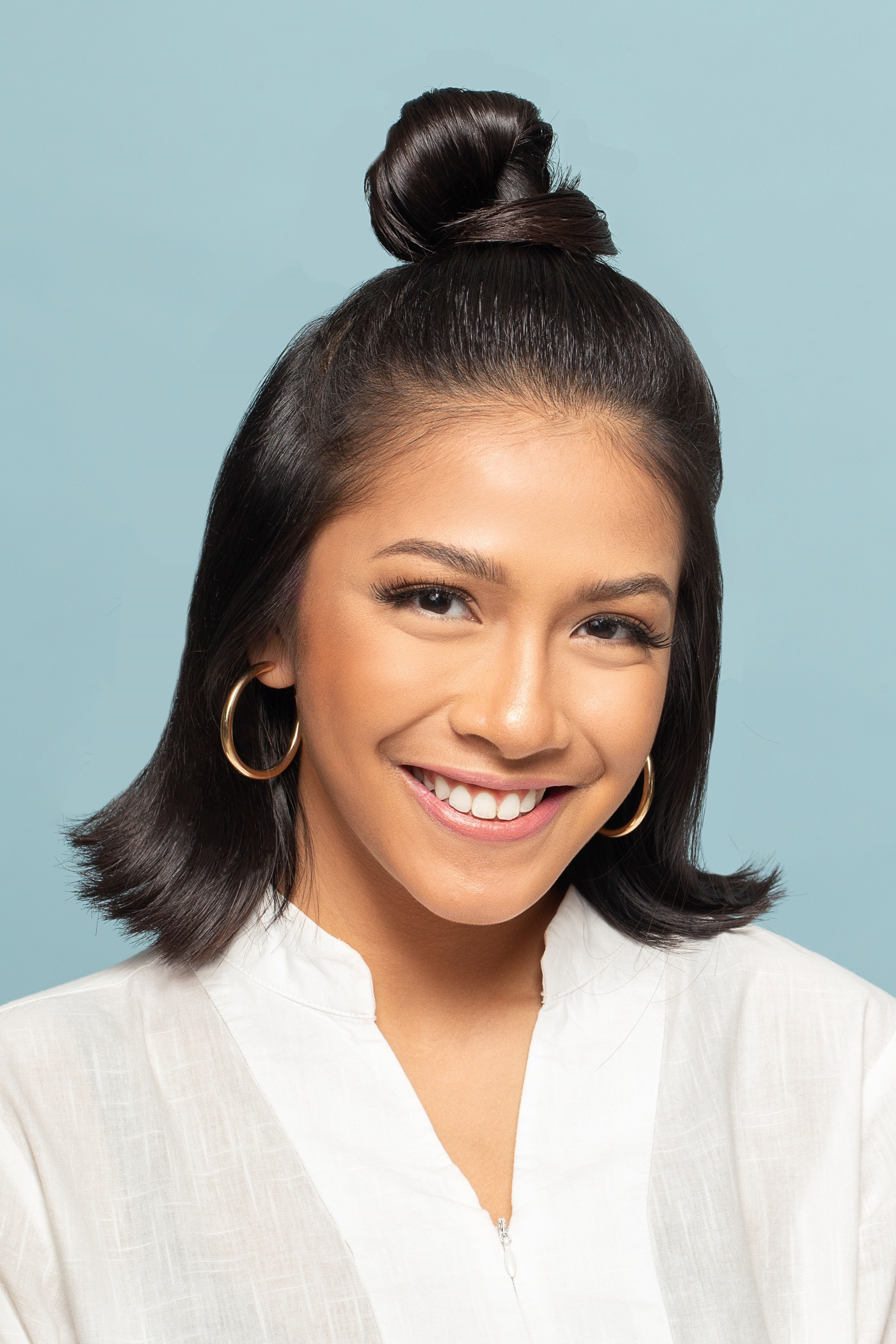 Half ponytail: Asian woman with medium length black hair in half up top knot