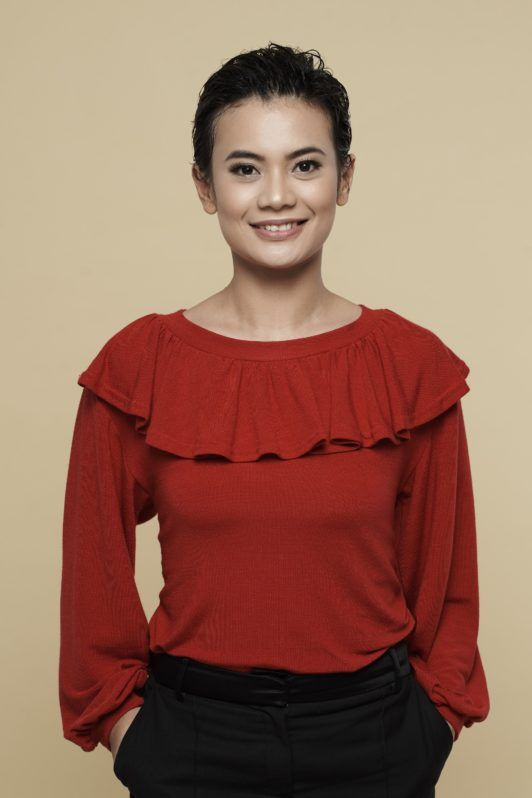 How to style wet to dry pixie: Asian woman with wet black pixie cut hair wearing a red blouse