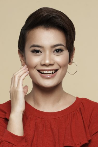 How to style wet to dry pixie: Closeup shot of an Asian woman with styled pixie cut wearing a red blouse
